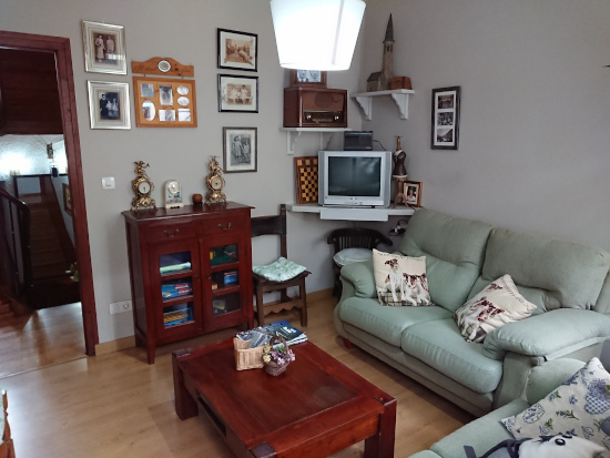 Salón de estar para habitaciones en Hostal Era Nheuada