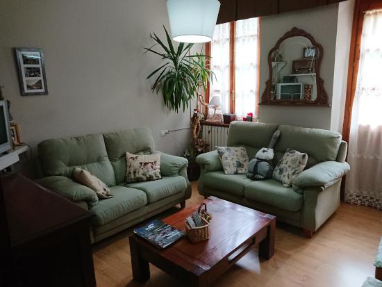 Sala de estar para habitaciones en Hostal Era Nheuada